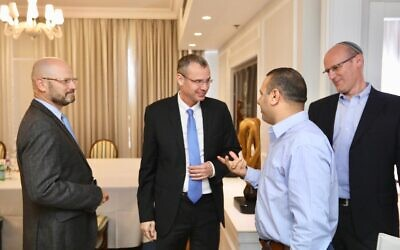 Blue and White coalition negotiators Yoram Turbowicz (L) and Shalom Shlomo (second from R) along with Likud's negotiators Tourism Minister Yariv Levin (second from L) and Michael Rabello (R) meet in Kfar Maccabiah on October 27, 2019. (Elad Malkah)