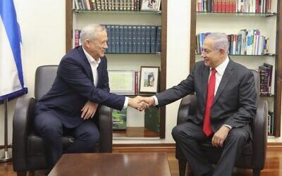 Blue and White party leader Benny Gantz (L) and Prime Minister Benjamin Netanyahu meet at IDF headquarters in Tel Aviv, on October 27, 2019. (Elad Malka)