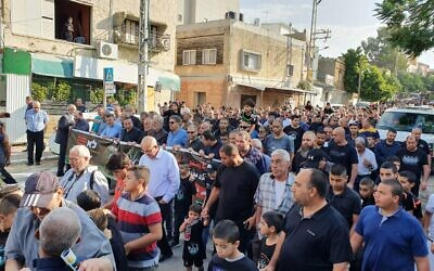 Hundreds marching through Kafr Qasim on October 29, 2019, to mark the 1956 massacre in which Border Police shot and killed 48 Arab Israelis. (Joint List)