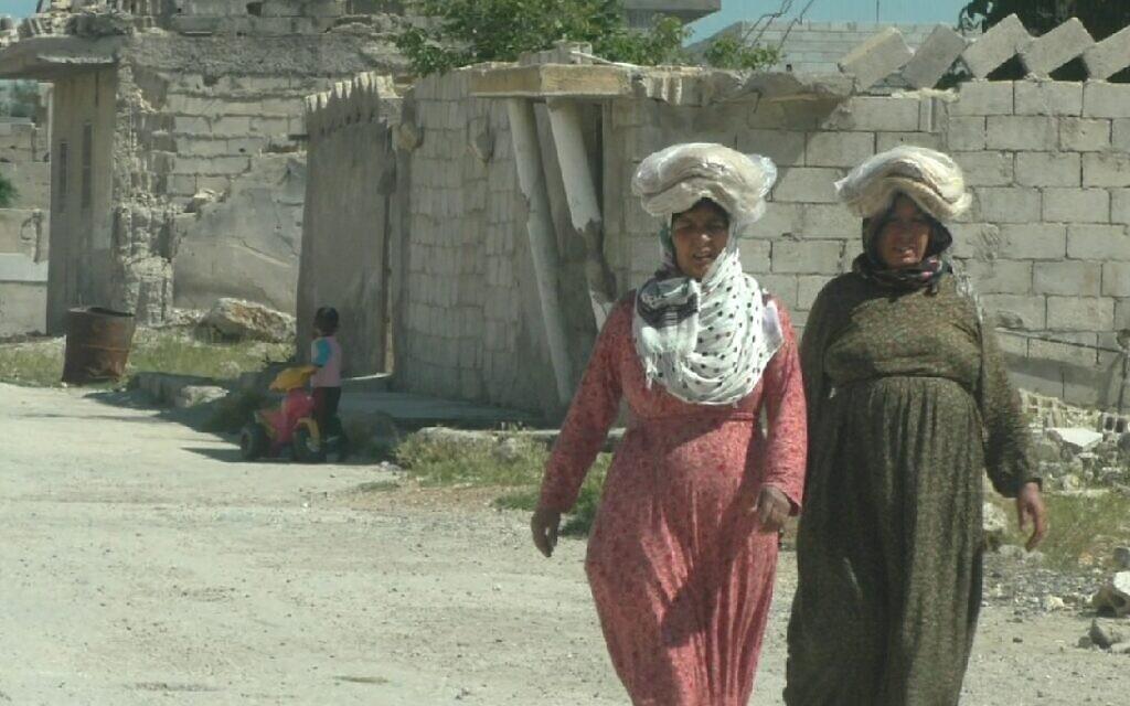 Women walk on the streets of Kobani, Syria. (Ziv Genesove/Times of Israel)