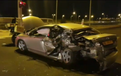 A car hit by a vehicle that attempted to flee police on the Ayalon Highway, October 25, 2019 (video screen grab)