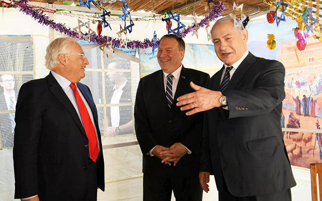 US Secretary of State Mike Pompeo visits the prime minister's Sukkah, during talks with Prime Minister Benjamin Netanyahu on October 18, 2019. At left is US Ambassador to Israel David Friedman (Amos Ben Gershom / GPO)
