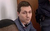 Aleksey Burkov during a court hearing in Israel (Channel 13 news)
