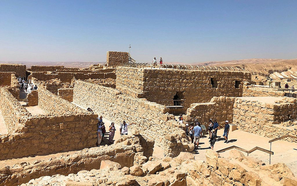 Tourists mingle at Masada, July 11, 2019. (Amanda Borschel-Dan/Times of Israel)