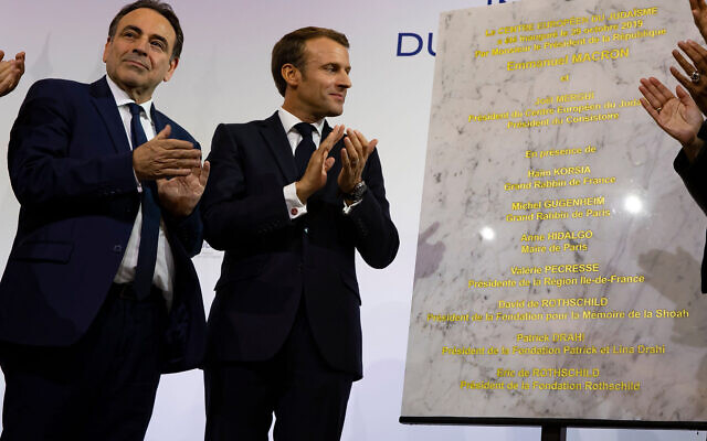 Consistoire President Joel Mergui, left, and French President Emmanuel Macron celebrate the inauguration of a new Jewish community center in Paris, October 29, 2019. (Consistoire)