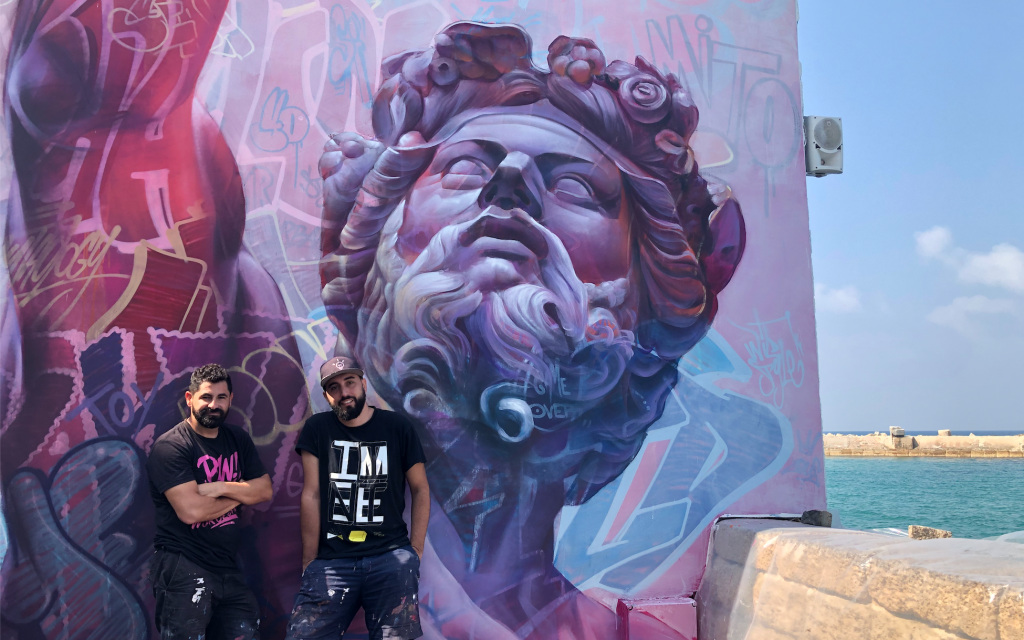 International street artists paint Jaffa's port in Sukkot celebration
