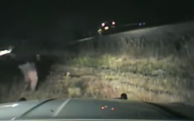Dashcam footage of a a Utah state trooper rushing to rescue a man from an oncoming train (video screenshot)