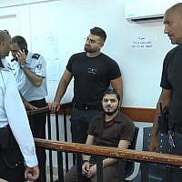 Hamza Faiz appears at the Ofer Military Court, on July 16, 2018. (Screen capture/Ynet)