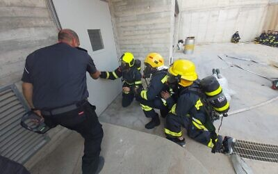 Palestinian Authority firefighters training at an Israeli fire academy on November 5, 2019 in Rishon Lezion. (Credit: COGAT)