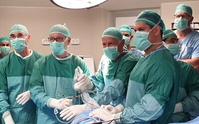 Surgeons at Israel's Yitzhak Shamir Medical Center, formerly the Assaf Harofeh hospital, performing the artificial meniscus implant on November 11, 2019. The implant was developed by US firm Active Implants LLC at its Netanya research and development center (Courtesy)