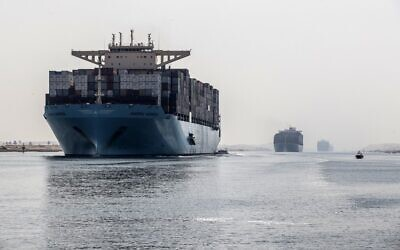 A container ship sails through the new section of the Suez Canal in the Egyptian port city of Ismailia, 135 kilometers northeast of the capital Cairo on October 10, 2019. (Khaled Desouki/AFP)
