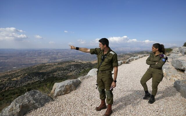 Israeli Army soldier Samuel Boujenah, center, gestures as he explains the Israel-Lebanon conflict to foreign journalists in the military base of Har Dov on Mount Hermon, a strategic and fortified outpost at the crossroads between Israel, Lebanon, and Syria, on October 30, 2019. (JALAA MAREY/AFP)