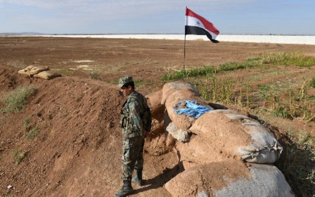 Syrian troops begin deploying along border with Turkey