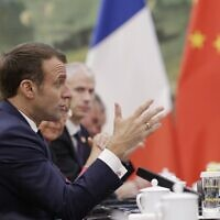 French President Emmanuel Macron speaks during a meeting with Chinese Premier Li Keqiang (not pictured) at the Great Hall of the People in Beijing on November 6, 2019. (JASON LEE / POOL / AFP)