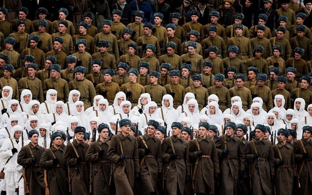 Russian servicemen dressed in historical uniforms march during the military parade at Red Square in Moscow on November 7, 2019, as part of the ceremonies marking the 78th anniversary of the 1941 historical parade, when Red Army soldiers marched past the Kremlin walls towards the front line to fight Nazi Germany troops during World War II. ( Dimitar DILKOFF / AFP)