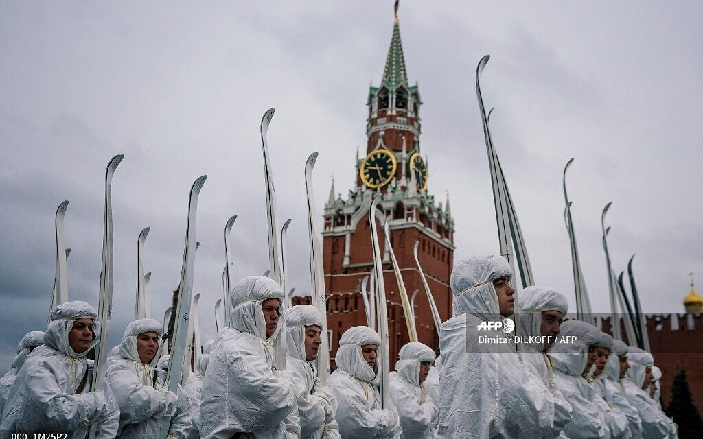 Russian servicemen dressed in historical uniforms march during the military parade at Red Square in Moscow on November 7, 2019, as part of the ceremonies marking the 78th anniversary of the 1941 historical parade, when Red Army soldiers marched past the Kremlin walls towards the front line to fight Nazi Germany troops during World War II. (Dimitar DILKOFF / AFP)