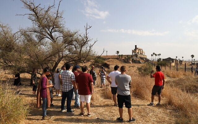 Israeli tourists visit the Naharayim peace park on November 8, 2019. (Menahem Kahana/AFP)