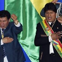 President of the lower house of Bolivia's parliament Victor Borda and President Evo Morales sing the national anthem during the celebration of the 194th anniversary of the country's independency, in Trinidad, Bolivia, August 6, 2019 (Aizar RALDES / AFP)