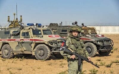 Russian military police take part in a joint Turkish-Russian army patrol near the town of Darbasiyah in Syria's northeastern Hasakeh province, along the Syria-Turkey border, November 11, 2019. (Delil Souleiman/AFP)