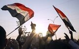 Iraqis demonstrate outside the Basra Governorate's building on November 11, 2019 in the southern city of Basra. (Photo by Hussein FALEH / AFP)