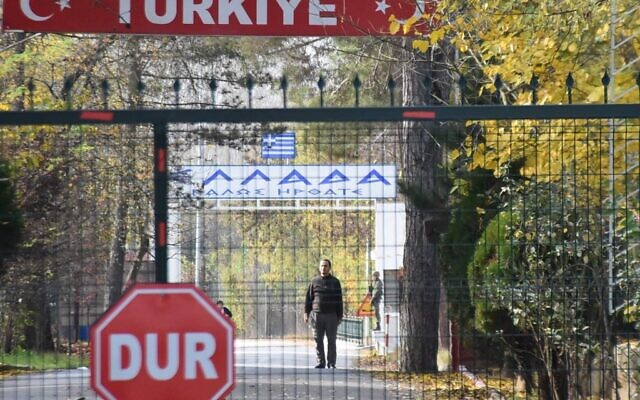 A man (C), allegedly an US citizen and a member of the Islamic State group (IS), who was deported by Turkish officials and rejected by Greek police, standing in a no man's land at the border between Turkey and Greece near Pazarkule, is seen from the Turkish side in Edirne, on November 11, 2019. (Photo by DHA / DHA / AFP) / Turkey OUT