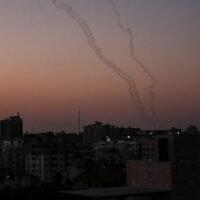 Illustrative: Palestinians fire rockets from Gaza City toward Israel on November 12, 2019. (Photo by MAHMUD HAMS / AFP)