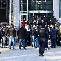 People arrive at the Ankara's courthouse on November 12, 2019, to attend the trial of 18 students and an academic allegedly involved in a banned LGBTI pride event at the campus university, in Ankara. (Photo by Adem ALTAN / AFP)