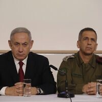 Prime Minister Benjamin Netanyahu (L) and IDF Chief of Staff Aviv Kohavi address the media at the Defense Ministry in Tel Aviv on November 12, 2019. (GIL COHEN-MAGEN / AFP)