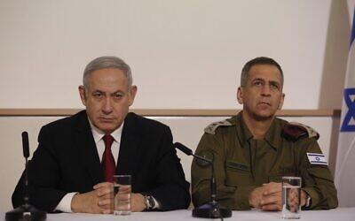 Prime Minister Benjamin Netanyahu (L) and IDF Chief of Staff Aviv Kohavi address the media at the Defense Ministry in Tel Aviv on November 12, 2019. (GIL COHEN-MAGEN / AFP)