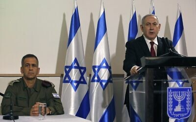Prime Minister Benjamin Netanyahu (right) and IDF Chief of Staff Aviv Kohavi during a press conference at the Defense Ministry in Tel Aviv on November 12, 2019 (GIL COHEN-MAGEN / AFP)