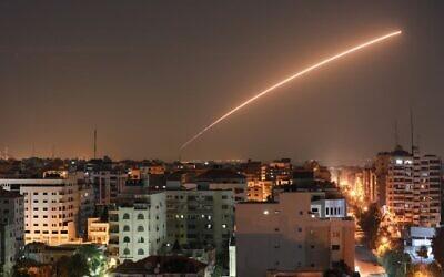 People take cover during an air-raid warning siren in Sderot, southern Israel, Wednesday, Nov. 13, 2019. (AP Photo/Ariel Schalit)