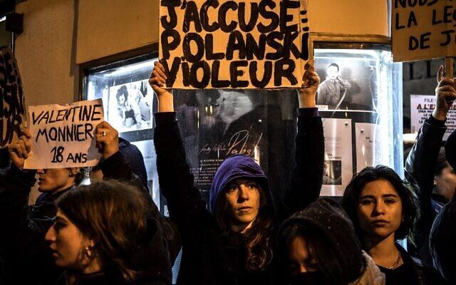 "Demonstrators hold banners reading ""I accuse: Polanski Rapist"" during a protest against French-Polish film director Roman Polanski outside the ""Champo"" cinema hall in Paris on November 12, 2019. (Christophe ARCHAMBAULT/AFP)"