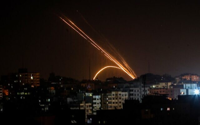 Illustrative: Rockets are fired from the Gaza Strip toward Israel on November 13, 2019. (Anas Baba/AFP)