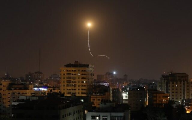 Illustrative: An Israeli missile launched from an Iron Dome missile defense system, designed to intercept and destroy incoming short-range rockets and artillery shells, is seen above Gaza City on November 13, 2019. (Mahmud Hams/AFP)
