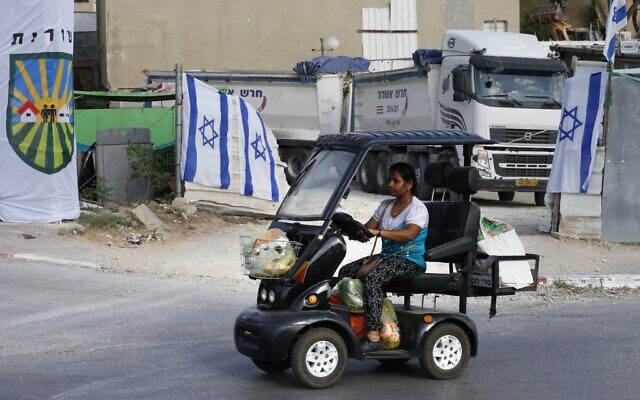 A woman uses a special vehicle to carry groceries in the southern Israeli city of Sderot on November 14, 2019. (Ahmad GHARABLI / AFP)