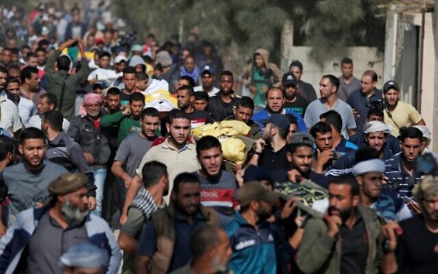 Palestinians attend the funeral procession of members of the same family who were killed overnight in an Israeli airstrike, on November 14, 2019 in Deir al-Balah.  (Mahmud Hams/AFP)