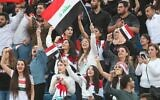Iraq fans cheer during the FIFA World Cup 2022 and the 2023 AFC Asian Cup qualifying soccer match between Iraq and Iran in the Jordanian capital Amman on November 14, 2019. (Khalil MAZRAAWI / AFP)