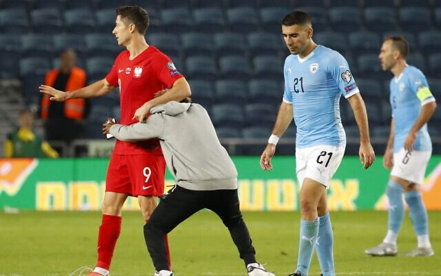 Poland Winter Olympics 2020.Security Guard Runs Into Polish Player As Pitch Intruder