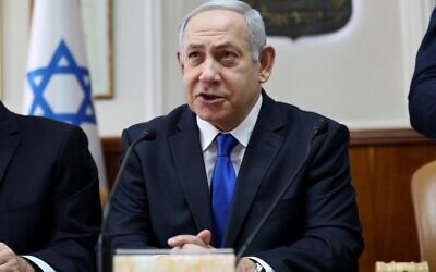 Prime Minister Benjamin Netanyahu opens the weekly cabinet meeting at his Jerusalem office on November 17, 2019. (GALI TIBBON / POOL / AFP)