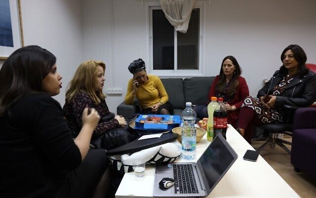 A picture taken on November 18, 2019, shows Israeli activists (L to R) Esti Shushan, Rachel Morgerstern, Hila Hassan Lefkowitz, Esther Twersky, and Yael Elimelech of the Nivcharot foundation, an Ultra-Orthodox feminist group, during a work meeting in the central city of Kfar Saba, on November 18, 2019. (MENAHEM KAHANA / AFP)