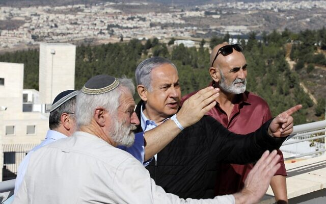 Prime Minister Benjamin Netanyahu (C) meets with heads of Israeli settlement authorities at the Alon Shvut settlement, in the Gush Etzion block in the West Bank on November 19, 2019. (Menahem Kahana/AFP)