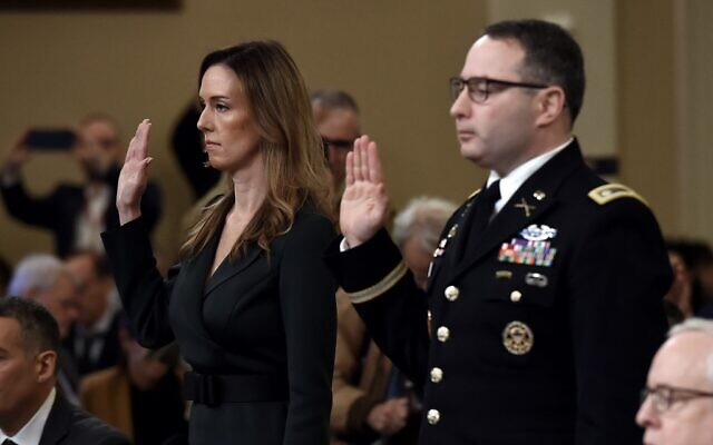 National Security Council Ukraine expert Lieutenant Colonel Alexander Vindman and Jennifer Williams, an aide to Vice President Mike Pence are sworn in before the House Intelligence Committee, on Capitol Hill in Washington, DC on November 19, 2019. (Olivier Douliery / AFP)
