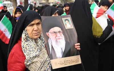 Iranian government supporters rally on November 20, 2019 in support of the Islamic republic's authorities and supreme leader, Ayatollah Ali Khamenei (portraits), in the cenral city of Arak, southwest of the capital Tehran (STR / AFP)