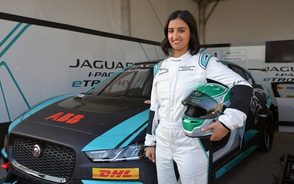 Reema al-Juffali, Saudi Arabia's first female race driver, poses in front of her car during an interview with AFP in Diriyah district in Riyadh on November 20, 2019. (Fayez Nureldine/AFP)
