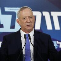 Blue and White leader Benny Gantz speaks to the press in Tel Aviv on November 20, 2019. (Jack Guez/AFP)