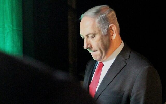 In this photo taken on February 14, 2018, Prime Minister Benjamin Netanyahu leaves the Muni World conference in Tel Aviv (Jack Guez/AFP)