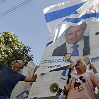 Supporters of Prime Minister Benjamin Netanyahu rally outside his Likud party's headquarters in Tel Aviv on November 22, 2019. (Jack Guez/AFP)