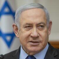 Prime Minister Benjamin Netanyahu chairs the weekly cabinet meeting at his office in Jerusalem on November 24, 2019. (Sebastian Scheiner/Pool/AFP)
