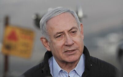 Prime Minister Benjamin Netanyahu visits an army base on the Golan Heights, November 24, 2019. (Atef Safadi/Pool/AFP)