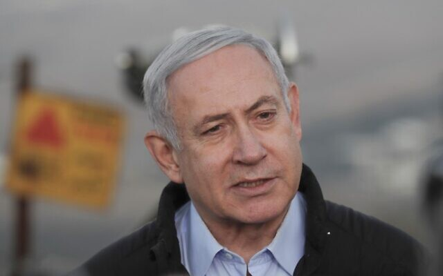 Prime Minister Benjamin Netanyahu visits an army base on the Golan Heights, November 24, 2019. (Atef Safadi/Pool/AFP)